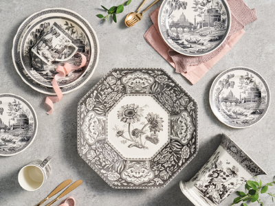 A mix of Spode Heritage collection with pink napkins and ribbon